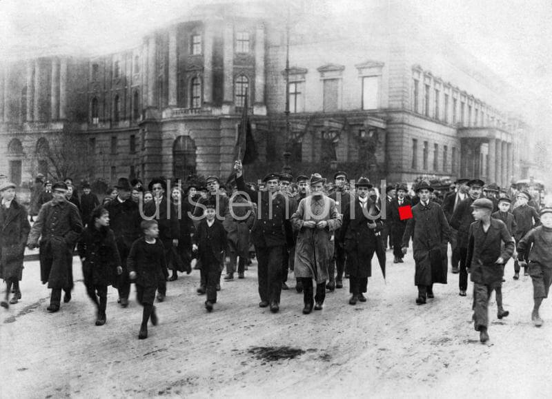 "Demonstration on ""Unter den Linden"" headed by a sailor with a red flag. November 1918"