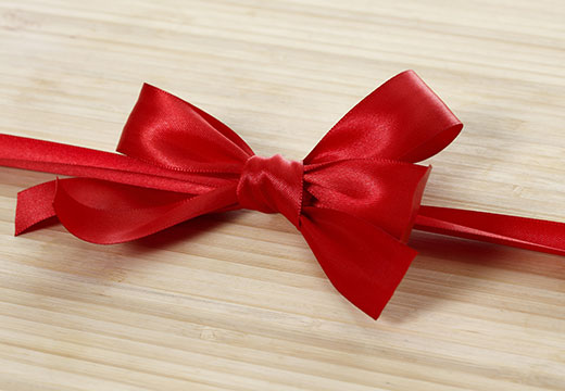 Symbolic photo for Historical Newspapers: red ribbon